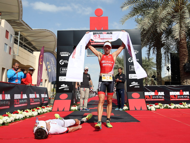 BAHRAIN, BAHRAIN - DECEMBER 05:  Bart Aernouts (R) of Germany celebrates winning Ironman Bahrain on December 5, 2015 in Bahrain, Bahrain.  (Photo by Nigel Roddis/Getty Images for Ironman)