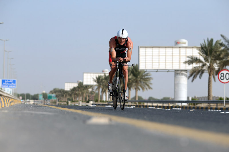 BAHRAIN, BAHRAIN - DECEMBER 05:  An athlete competes during the bike section of Ironman Bahrain on December 5, 2015 in Bahrain, Bahrain.  (Photo by Nigel Roddis/Getty Images for Ironman)