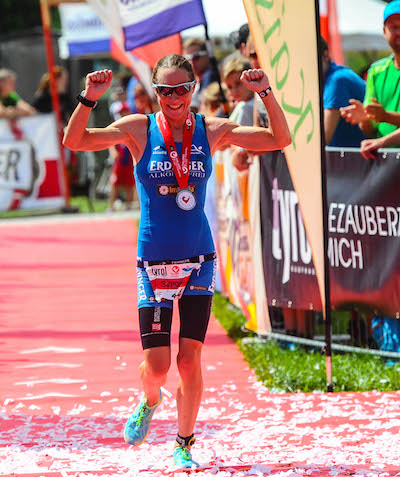 WALCHSEE, AUSTRIA - AUGUST 23:  Simone Braendli of Switzerland celerbates as she wins the Challenge Triathlon Walchsee-Kaiserwinkl on August 23, 2015 in Walchsee, Austria.  (Photo by David Ramos/Getty Images for Challenge Triathlons) *** Local Caption *** Simone Braendli