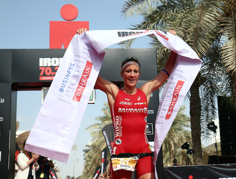 BAHRAIN, BAHRAIN - DECEMBER 05:  Daniela Ryf of Switzerland celebrates winning the Triple Crown and 0ne million dollars after winning Ironman Bahrain on December 5, 2015 in Bahrain, Bahrain.  (Photo by Nigel Roddis/Getty Images for Ironman)
