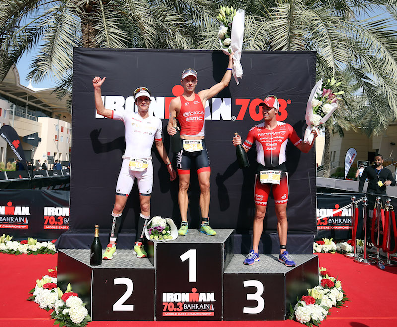 BAHRAIN, BAHRAIN - DECEMBER 05:  Bart Aernouts (C) of Germany celebrates winning Ironman Bahrain with Ruedi Wild (L) of Switzerland second and James Cunnama (R) of South Africa third on December 5, 2015 in Bahrain, Bahrain.  (Photo by Nigel Roddis/Getty Images for Ironman)