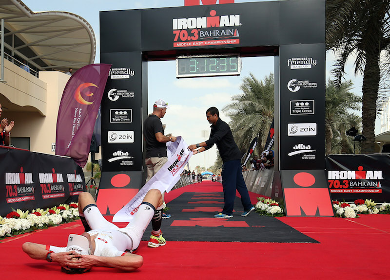 BAHRAIN, BAHRAIN - DECEMBER 05:  Ruedi Wild (L) of Switzerland reacts after finishing second at Ironman Bahrain on December 5, 2015 in Bahrain, Bahrain.  (Photo by Nigel Roddis/Getty Images for Ironman)