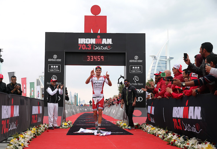 DUBAI, UNITED ARAB EMIRATES - JANUARY 29:  Jan Frodeno of Germany celebrates winning the Men's IRONMAN 70.3 Dubai on January 29, 2016 in Dubai, United Arab Emirates.  (Photo by Warren Little/Getty Images for Ironman)