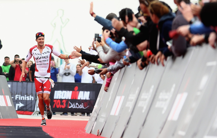 DUBAI, UNITED ARAB EMIRATES - JANUARY 29:  Jan Frodeno of Germany acknowledges the crowd as he wins the Men's IRONMAN 70.3 Dubai on January 29, 2016 in Dubai, United Arab Emirates.  (Photo by Warren Little/Getty Images for Ironman)