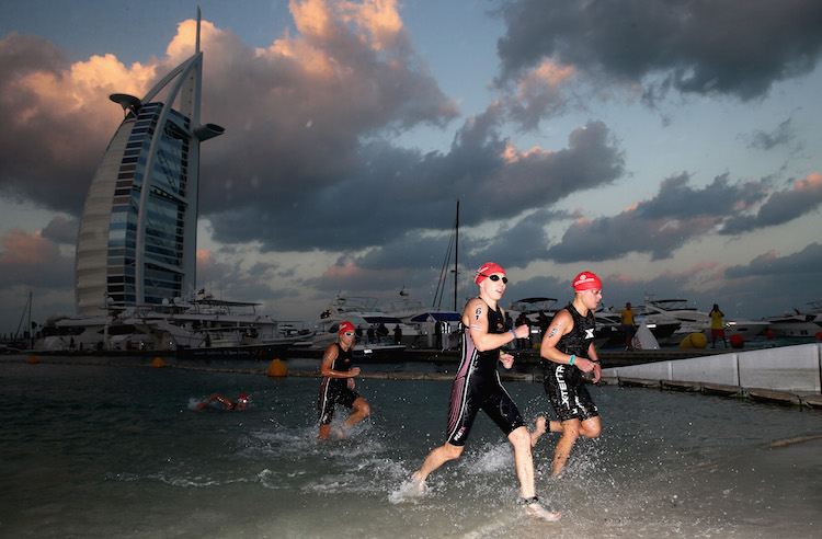 DUBAI, UNITED ARAB EMIRATES - JANUARY 29:  (L_R) Jocelyn McCauley of the USA and Andrea Forrest of Australia race in the Women's IRONMAN 70.3 Dubai on January 29, 2016 in Dubai, United Arab Emirates.  (Photo by Warren Little/Getty Images for Ironman)