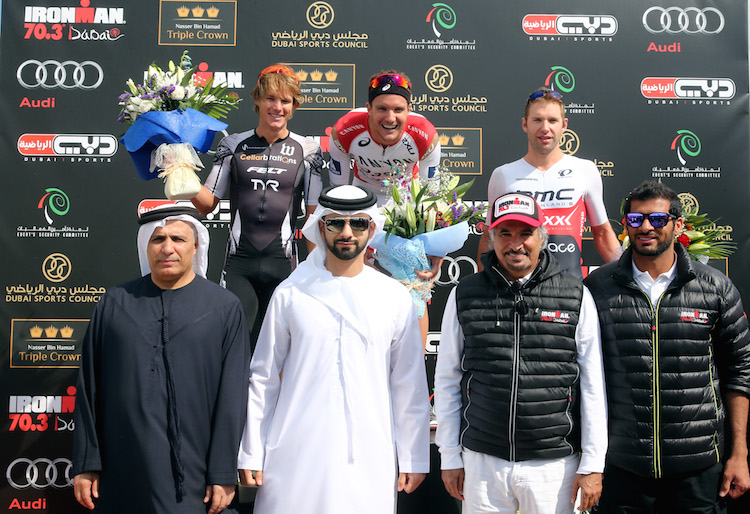 DUBAI, UNITED ARAB EMIRATES - JANUARY 29:  (L_R backrow) Josh Amberger of Australia, Jan Frodeno of Germany, Bart Aernouts of Belgium pose with Mattar Al Tayer, Chairman of the Board and Executive Director of RTA, Sheikh Mansoor Bin Mohammed Bin Rashid, His Excellency Saeed Hareb, Secretary General of the Dubai Sports Council and Ahmed Al Haj Jber , Managing Director IRONMAN 70.3 Dubai after the IRONMAN 70.3 Dubai on January 29, 2016 in Dubai, United Arab Emirates.  (Photo by Warren Little/Getty Images for Ironman)