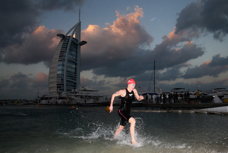 DUBAI, UNITED ARAB EMIRATES - JANUARY 29:  Daniela Ryf of Switzerland leaves the water after the swim en route to winning the Women's IRONMAN 70.3 Dubai on January 29, 2016 in Dubai, United Arab Emirates.  (Photo by Warren Little/Getty Images for Ironman)